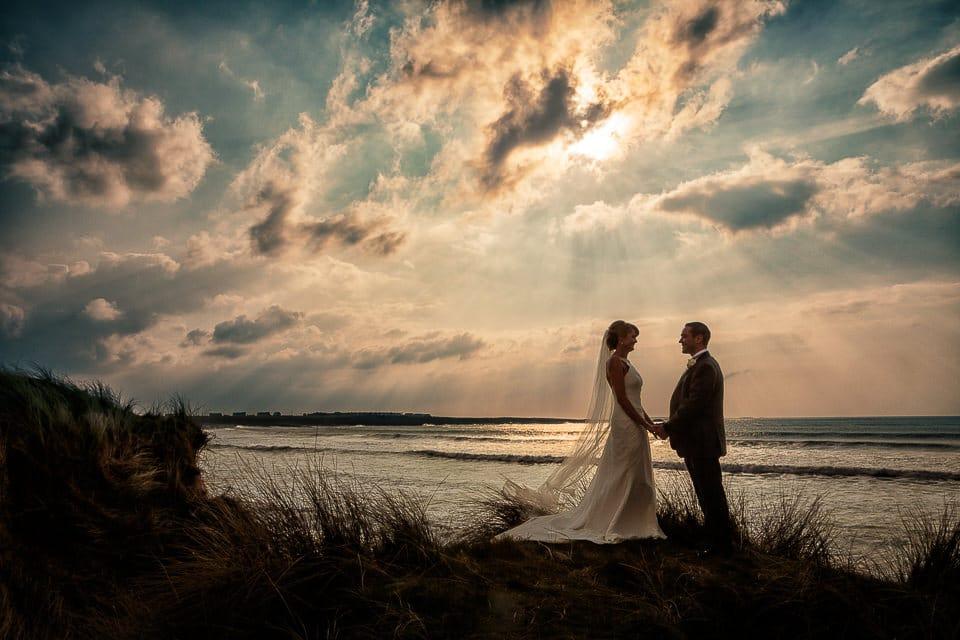 dramatic sunset wedding photographer