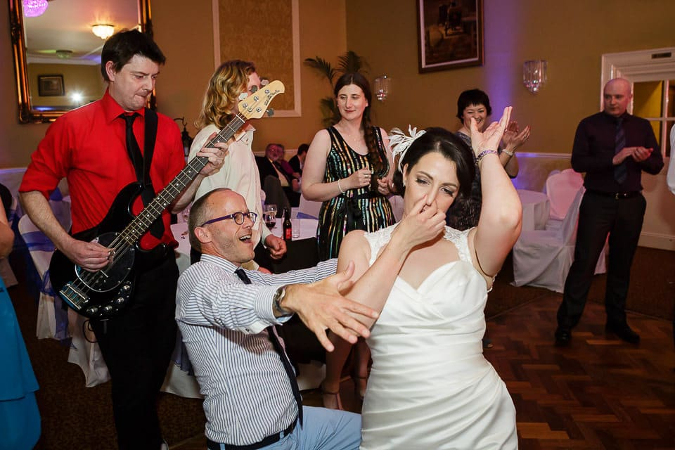 fun dancing wedding photographer