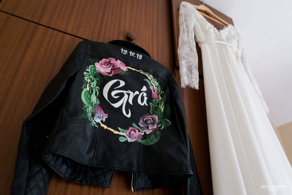 brides dress and leather jacket